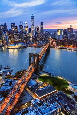 USA11582AW Aerial of lower Manhattan skyline and Brooklyn bridge at dusk, New York, USA