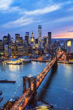 USA11584AW Aerial of lower Manhattan skyline and Brooklyn bridge at dusk, New York, USA