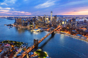 USA11585AW Aerial of lower Manhattan skyline and Brooklyn bridge at dusk, New York, USA
