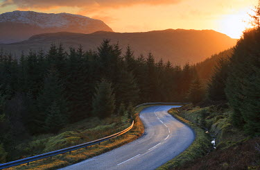 SCO34226AW Scotland, Highland. The Ratagan Pass road winding through the hills at sunset.