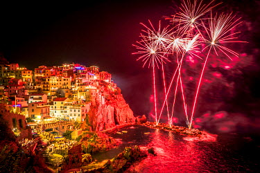 ITA9364AW Europe, Italy, Liguria. Fireworks in Manarola for San Lorenzo.