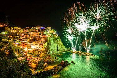 ITA9365AW Europe, Italy, Liguria. Fireworks in Manarola for San Lorenzo.