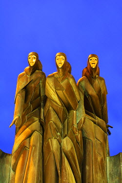"LIT1191AW The sculpture �Three Muses"" by Stanislovas Kuzma crowning the main entrance to the National Drama Theatre has become an icon of Vilnius. The muses of Drama (Calliope), Comedy (Thalia) and Tragedy (Mel..."