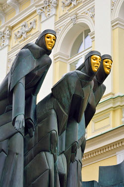 "LIT1193AW The sculpture �Three Muses"" by Stanislovas Kuzma crowning the main entrance to the National Drama Theatre has become an icon of Vilnius. The muses of Drama (Calliope), Comedy (Thalia) and Tragedy (Mel..."
