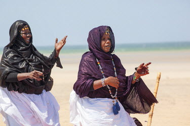 AF29ALA0099 Africa, Western Sahara, Dakhla. Two women in traditional dress performing a dance for tourists.