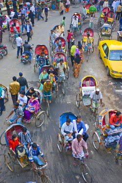 Very busy rickshaw traffic on a street crossing in Dhaka, Bangladesh, Asia