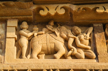 AS10JRA1022 Elephant and erotic sculptures of Khajuraho, Madhya Pradesh, India.