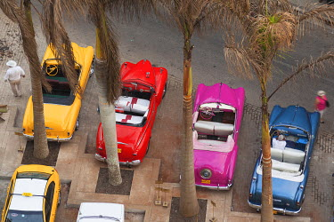 CA11BTH0153 Cuba, Havana. Overhead view of colorful classic cars.