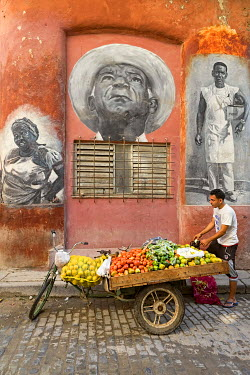 CA11BTH0076 Cuba, Havana. Fruit and produce vendor in the old town section of Havana.
