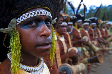 OC12MRU0044 Colorful dress and face painted local tribes celebrating the traditional Sing Sing in Enga in the Highlands of Papua New Guinea, Melanesia