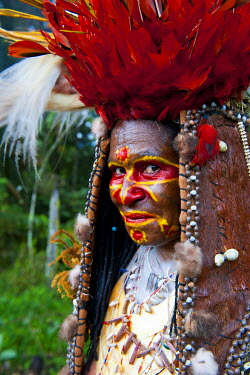 OC12MRU0234 Colorful dress and face painted local tribal woman celebrating the traditional Sing Sing in Paya in the Highlands of Papua New Guinea, Melanesia