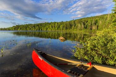 US20JMO1591 A canoe on the shore of Bald Mountain Pond. Bald Mountain Township, Maine.