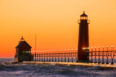 US23RDY0032 Grand Haven South Pier Lighthouse at sunset on Lake Michigan, Ottawa County, Grand Haven, Michigan