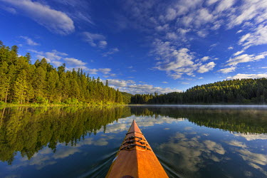 US27CHA3438 Kayaking on Beaver Lake in the Stillwater State Forest near Whitefish, Montana, USA