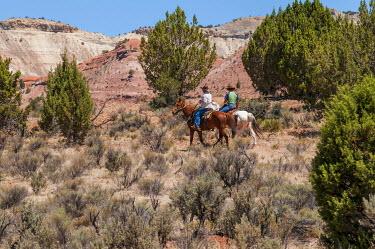 US45MDE0135 Horseback riding near Tropic, Utah, USA.