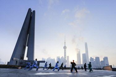 CN03632 Tai Chi on The Bund (with Pudong skyline behind), Shanghai, China