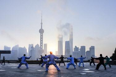 CN03633 Tai Chi on The Bund (with Pudong skyline behind), Shanghai, China