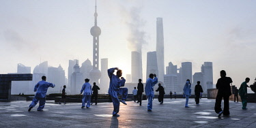 CN03636 Tai Chi on The Bund (with Pudong skyline behind), Shanghai, China