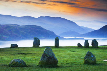 ENG13844AW Morning Mist behind Castlerigg Stone Circle, Lake District National Park, Cumbria, England