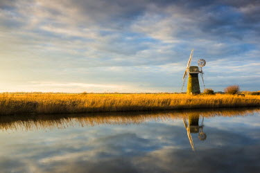ENG13972AW St. Benet's Mill Reflecting in River Thurne, Norfolk Broads National Park, Norfolk, England