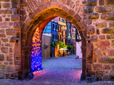 FRA9453AW Gate of Riquewihr at Night, Alsace, France