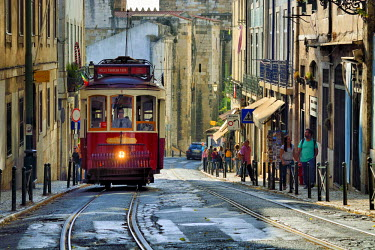 POR9090AW A tramway in Alfama district with the Motherchurch (Se Catedral) in the background. Lisbon, Portugal