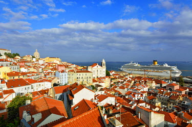 POR9093AW The traditional and moorish Alfama district and a cruise ship on the Tagus river. Lisbon, Portugal