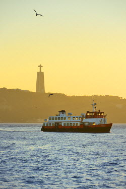 POR9110AW A traditional passenger boat (cacilheiro) crossing the Tagus river between Almada and Lisbon. Portugal