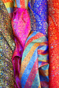 ISR0105 Israel, Akko. Silk on display at an outlet in the market. Unesco.