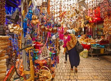 ISR0155 Israel, Akko. Muslim woman walking through a street in the market. Unesco.