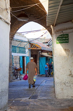 ISR0159 Israel, Akko. A Muslim men walking through the streets of the old town. Unesco.