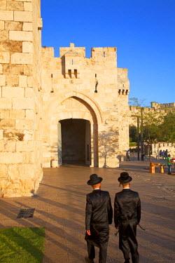 ISR0172 Israel, Jerusalem. Jews about the enter Old Jeruslaem through Jaffa Gate to celebrate Shabbat. Unesco.