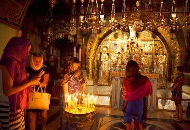 ISR0212 Israel, Jerusalem. Believers at the Chapel of Calvary. Unesco.