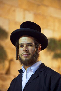 Israel, Jerusalem. A young Orthodox Jew at the Western Wall during the Tisha B'Av final day or 9 Av which is the most intense with Jews sleeping the night out under the stars near the wall. Unesco.