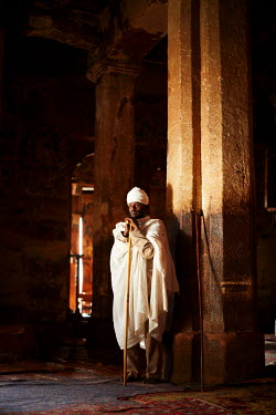 ETH3084AW Priest praying silently in the rock hewn church, Ethiopia, Africa