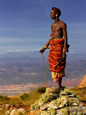 KEN10270AW Samburu warrior standing on Mt Ololokwe, Kenya, Africa