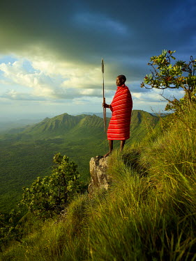 KEN10315AW Samburu warrior looks out over the rift valley, Kenya, Africa