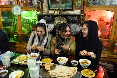 HMS2481842 Iran, Isfahan Province, Isfahan, Chai Khaneh Azadegan Tea House and restaurant, young iranian women student in medical engineering whose name are, from left to right, Pita, Nadia and Niloufar (no mode...