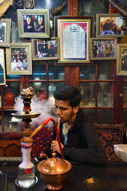 HMS2481868 Iran, Isfahan Province, Isfahan, Chai Khaneh Azadegan Tea House and restaurant, man smoking a water pipe