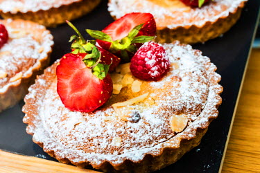 SCO34289AW Strawberry Almond Tart in bakery in Glasgow, Scotland.