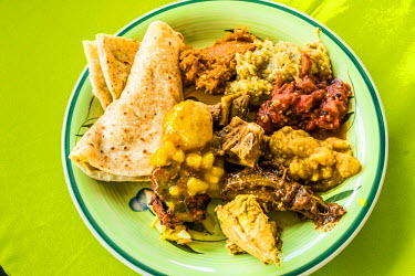 TTB0091AW Port of Spain, Trinidad and Tobago,  West Indies, Close-Up Of a home cooked East Indian plate, a popular cuisine in Trinidad.