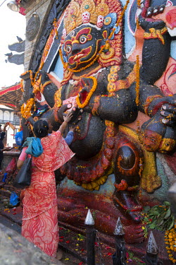 HMS2148493 Nepal, Kathmandu, Durbar Square, listed as World Heritage by UNESCO, statue of Kala (Black) Bhairab, fearsome representation of Shiva (archives)