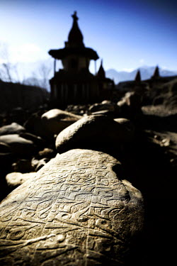 Nepal, Gandaki zone, Upper Mustang (near the border with Tibet), Mani wall (stones inscribed with a buddhist mantra) and stupa (chorten) in the village of Tangge