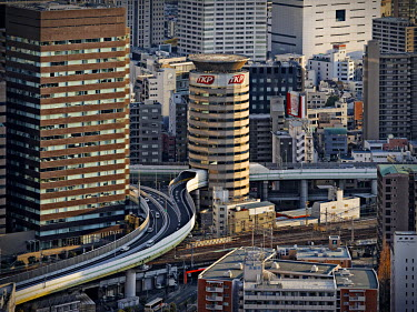 HMS2466383 Japan, Honshu island, Kansai, Osaka, expressway going through a building