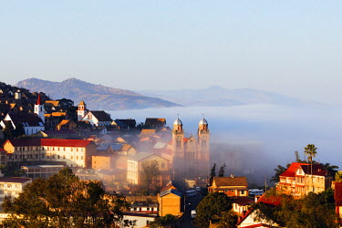 MAD0930 Africa, central Madagascar, Fianarantsoa, early morning mist on the Haute Ville old town, Ambozontany Cathedral