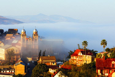 MAD0931 Africa, central Madagascar, Fianarantsoa, early morning mist on the Haute Ville old town, Ambozontany Cathedral