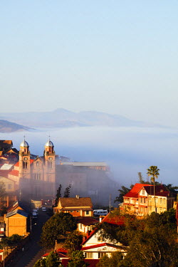 MAD0932 Africa, central Madagascar, Fianarantsoa, early morning mist on the Haute Ville old town, Ambozontany Cathedral