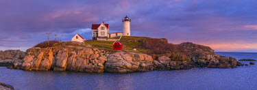 US16242 USA, Maine, York Beach, Nubble Light Lighthouse with Christmas decorations, dusk