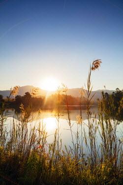SWA0033 Swaziland, Mlilwane Wildlife Sanctuary, lakeside scenery at sunset