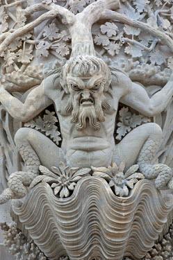 POR9130 Portugal, Sintra.  A sculpture depicting Triton, the mythological Greek god and messenger of the sea, graces the facade of the Pena Palace, or Palacio da Pena, in the Sintra Mountains near Lisbon.
